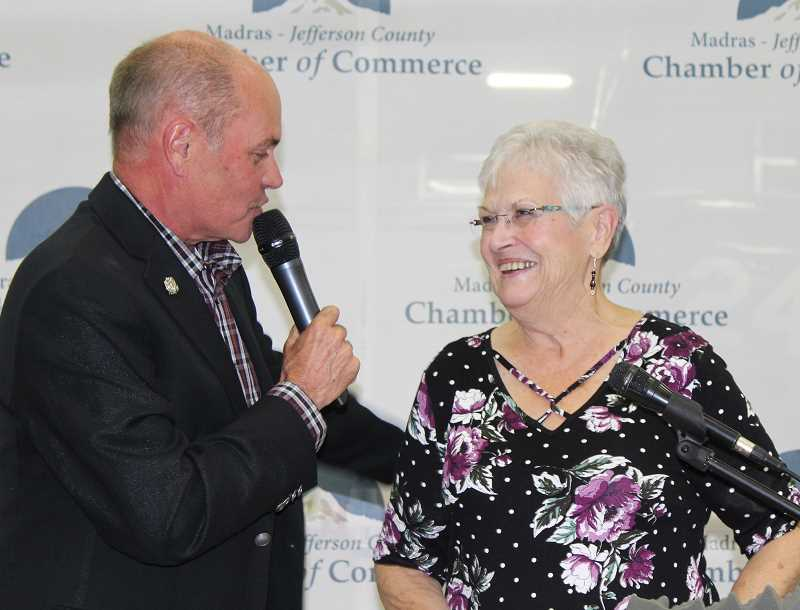 HOLLY M. GILL/MADRAS PIONEER - Rick Allen, a longtime chamber member, introduces Helen Houts, at the Madras-Jefferson County Chamber of Commerce Banquet Sept. 20. Houts, who has worked as the office manager at the chamber since 2006, retires Sept. 28. Her retirement party is Thursday, Sept. 27, from 11:30 a.m. to 2 p.m. at the chamber.