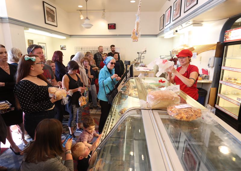 TIMES PHOTO: JAIME VALDEZ - The scene Thursday, Sept. 27, inside Beaverton Bakery, which announced it is closing after 93 years in business as customers buy baked goods, breads and cakes.
