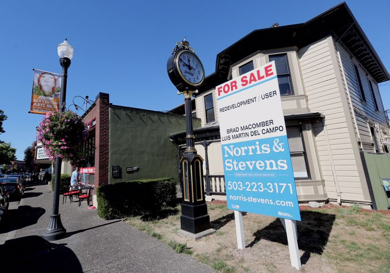 TIMES PHOTO: JAIME VALDEZ - Part of the three-building site of Beaverton Bakery, which announced it is closing after 93 years in business. The Queen Anne-style home was built in 1887 by Francis Marion Robinson, Beaverton's first doctor, and predates the bakery. The clock was built between 1912 and 1915, but was placed on the site in 1983.