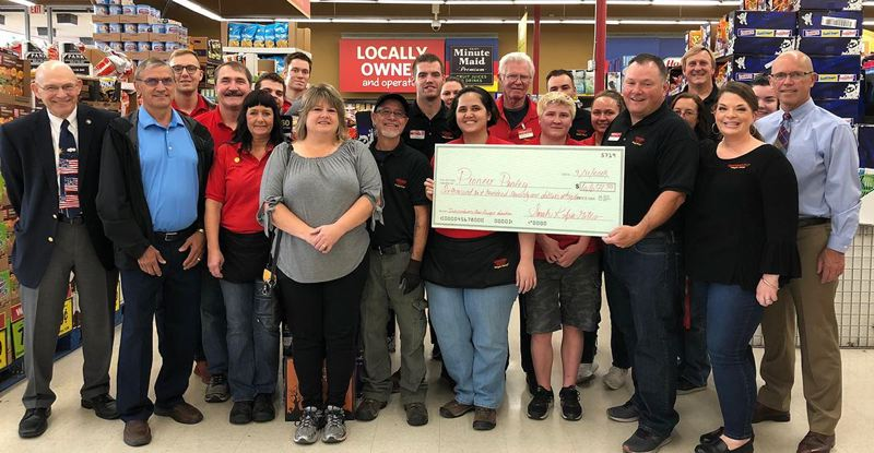 SUBMITTED PHOTO - Members of the Pioneer Pantry Board accept a check from employees at the Oregon City Grocery Outlet store.