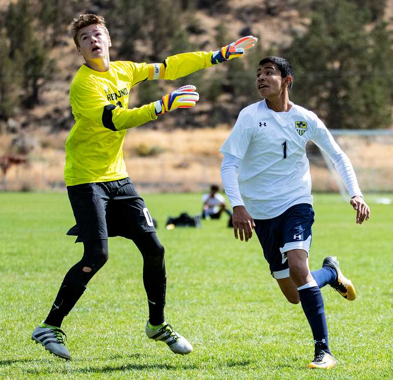 CENTRAL OREGONIAN FILE PHOTO - Redmond High School goalkeeper Hunter Holmes, left, plays against Crook County High School on Sept. 30, 2017. He suffered a concussion a few weeks later during a game and then committed suicide in mid December.