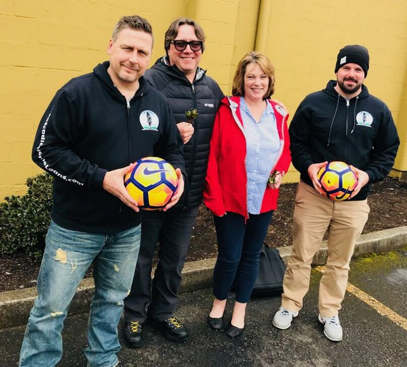 COURTESY PHOTO - From left to right: Simon Date, Matt McHugh, Theresa Muth and Scott Stanton pose for a quick photo. The group of coaches, community members and soccer enthusiasts helped kick off a soccer team fundraiser for Scappoose and St. Helens athletes to sell trees, which will then be planted this fall along the Crown Zellerbach Trail. The athletes will face off for their own 7 Mile War games on Oct. 23.