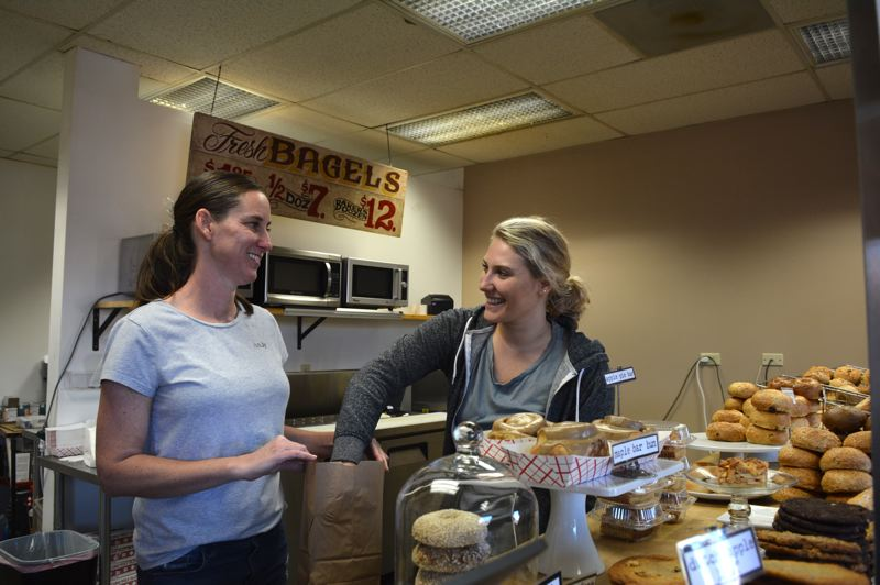 SPOTLIGHT PHOTO: COURTNEY VAUGHN - Andy McCandless (left) and Mary Rotter serve up bagels and baked goods at Scappoose Bagel on a Thursday morning. Each Thursday in October, tips left at the shop will be matched by local businesses and donated to Michelles Love.