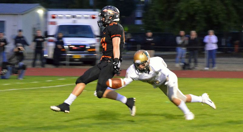 PHOTO COURTESY: JOHN BREWINGTON - Connor McNabb dances into the end zone at Scappoose High for a touchdown that gives the Indians a 14-0 lead against Pendleton on Sept. 21.