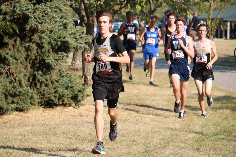 PAMPLIN MEDIA GROUP PHOTO: JIM BESEDA - Cash Lapping of St. Helens competes in cross country.
