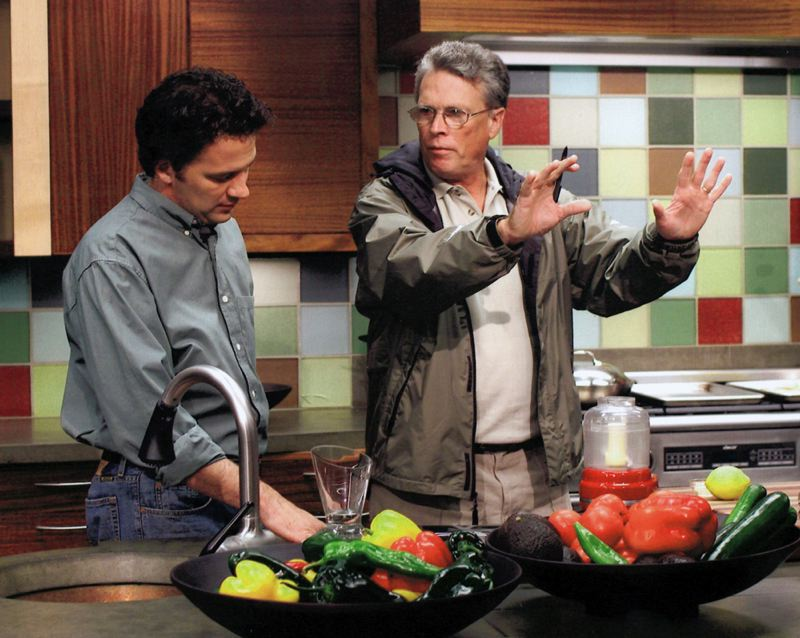 CONTRIBUTED PHOTO - Clark Santee directs a 2003 episode of Caprial and Johns Kitchen, a cooking show produced by Oregon Public Broadcasting.