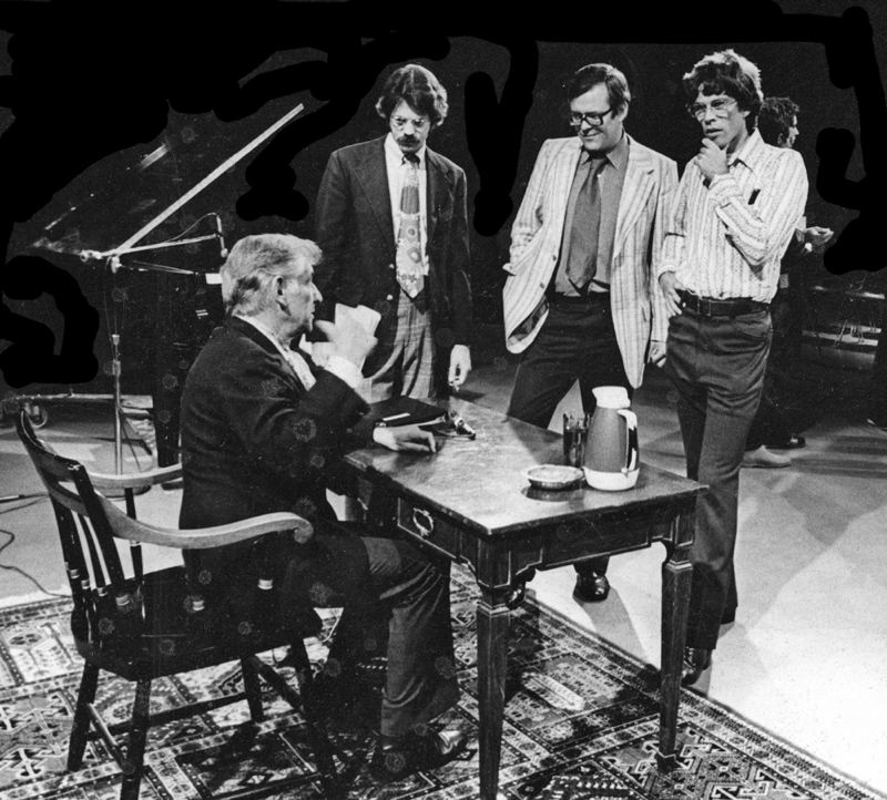 CONTRIBUTED PHOTO - Leonard Bernstein, seated, talks with Clark Santee, far right, in 1973 on the set of The Unanswered Question.