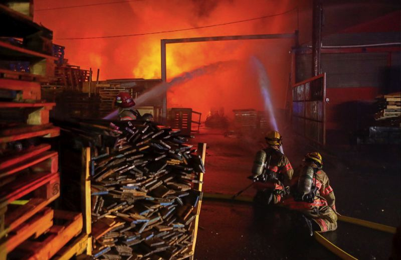 COURTESY GREG MUHR/PORTLAND FIRE AND RESUCE - Portland Fire & Rescue crews battle a blaze in North Portland on Friday, Sept. 28.