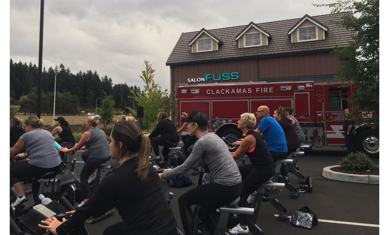 PHOTO COURTESY: TRACEY GRISHAM - Stationary cyclists participate in StarCycle Happy Valleys charity ride to raise over $3,000 for the Clackamas Emergency Services Foundation.