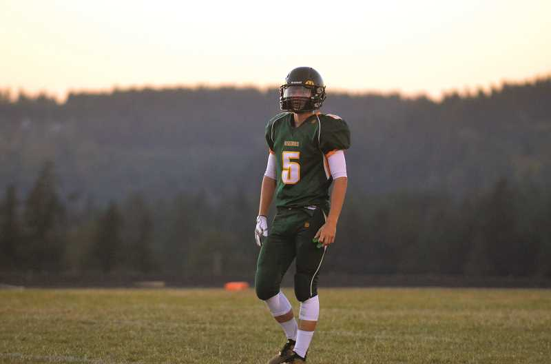 PIONEER PHOTO: TANNER RUSS - Colton senior Wyatt Earls was part of the potent offensive attack in the first half. The Vikings scored 61 points against Gervais on Friday, Sept. 28.
