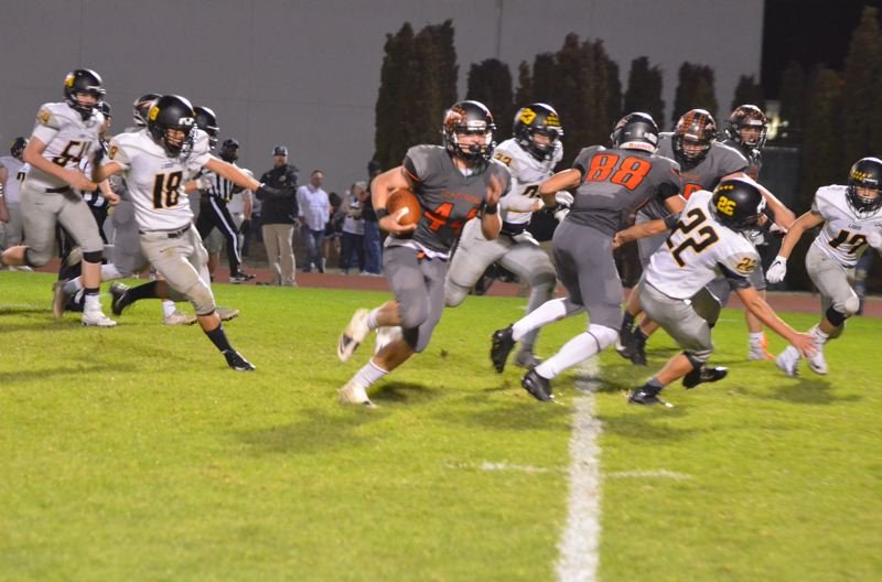 PHOTO COURTESY: JOHN BREWINGTON - Connor McNabb cuts back on a long run for Scappoose in its victory at home against St. Helens on Friday night.