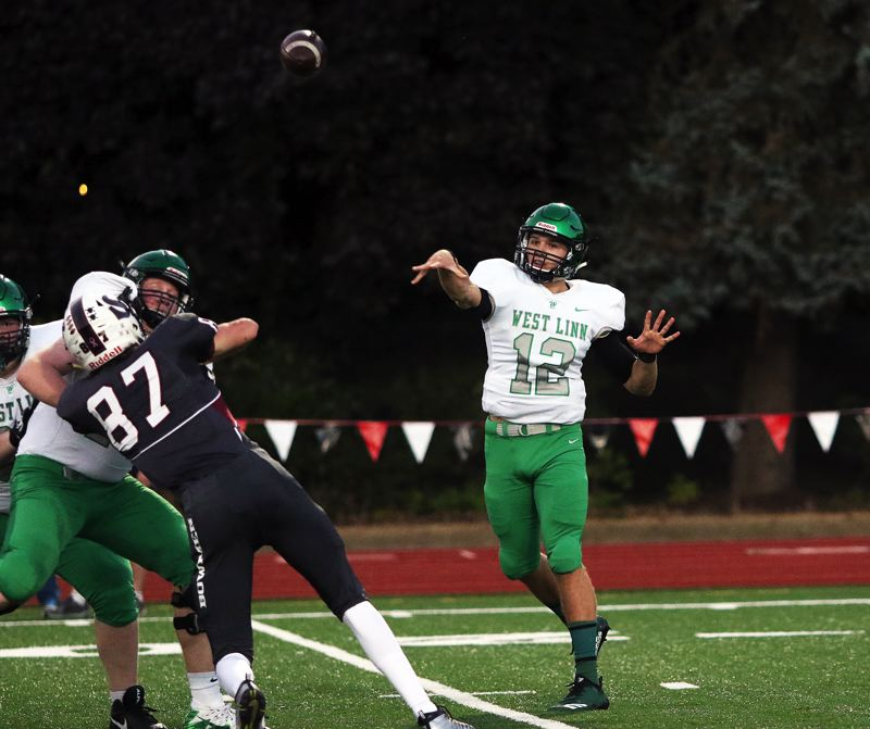 TIMES PHOTO: DAN BROOD - West Linn senior quarterback Ethan Long throws a pass during the first quarter of Friday's game at Sherwood.