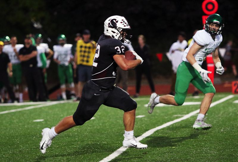 TIMES PHOTO: DAN BROOD - Sherwood senior fullback Ian Stormont breaks free for a 33-yard gain during the first quarter of Friday's game.