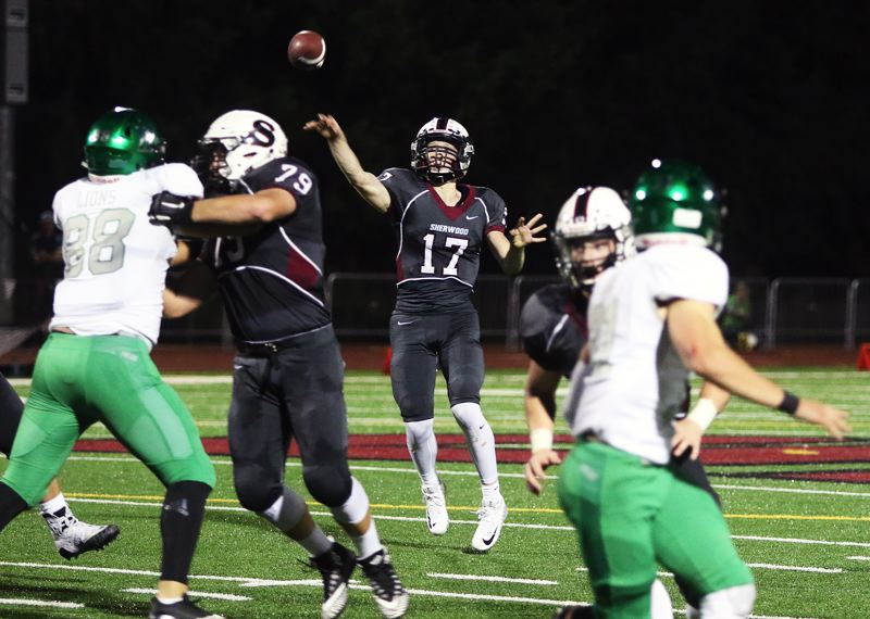 TIMES PHOTO: DAN BROOD - Sherwood senior quarterback Cade Chidester (17) throws a pass during Friday's game against West Linn.