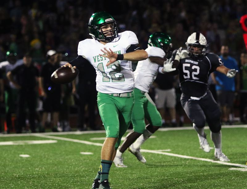 TIMES PHOTO: DAN BROOD - West Linn senior quarterback Ethan Long gets ready to throw a pass during Friday's game at Sherwood.