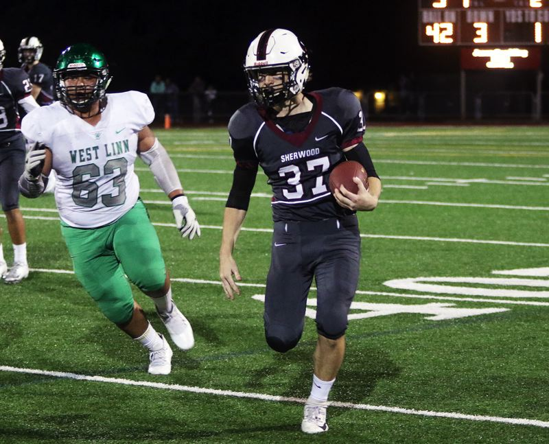 TIMES PHOTO: DAN BROOD - Sherwood sophomore running back Clay Peden gets to the sideline during Friday's game with West Linn.