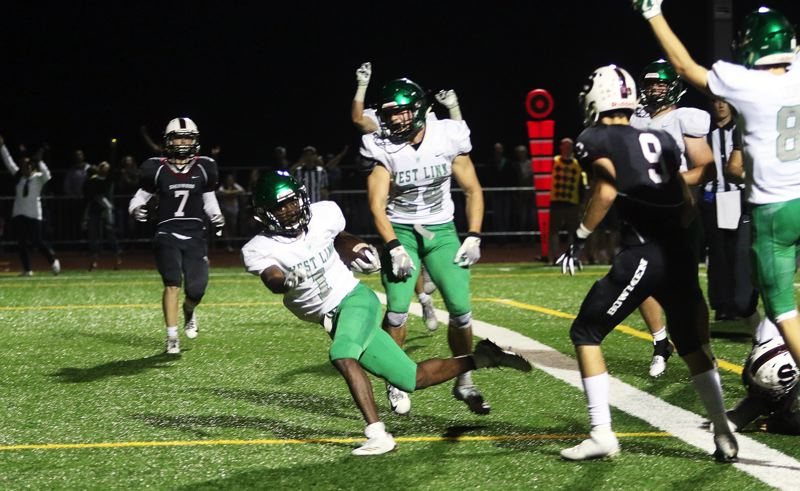 TIMES PHOTO: DAN BROOD - West Linn senior Dawson Jolley (1) gets into the end zone for the game-winning touchdown in the Lions' 26-20 double-overtime win at Sherwood.