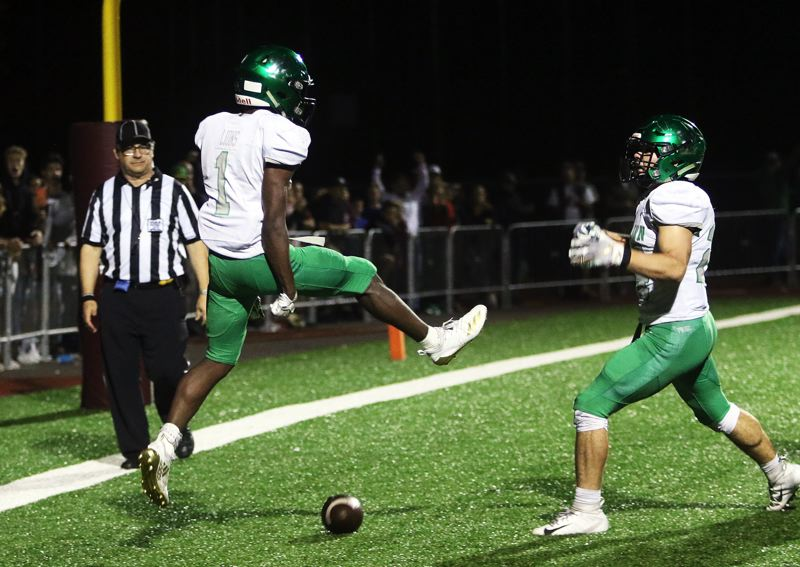 TIMES PHOTO: DAN BROOD - West Linn senior Dawson Jolley (left) and sophomore Cole Peters celebrate following Jolley's game-winning touchdown in Friday's game at Sherwood.