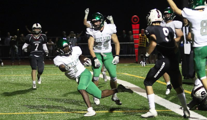 PAMPLIN MEDIA GROUP PHOTO: DAN BROOD - West Linn running back Dawson Jolley breaks into the end zone to score at the end of his team's 26-20 double-overtime win against Sherwood on Friday night.