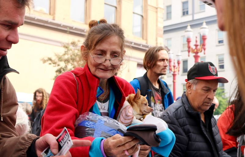 TRIBUNE PHOTO: ZANE SPARLING - Pauline Greer and her chihuahua Chico pick up supplies for the winter months during the 18th-annual Operation Overcoat at Union Gospel Mission on Saturday, Sept. 29.