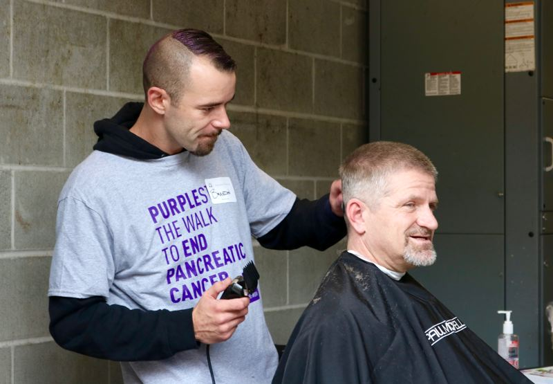 TRIBUNE PHOTO: ZANE SPARLING - A man gets a free haircut at Operation Overcoat on Saturday, Sept. 29.