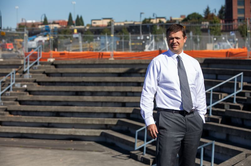 PAMPLIN MEDIA GROUP: JONATHAN HOUSE - onathan Eder project manager for the Terminal One Project, stands on the Vancouver waterfront. The first improvements planned include a public market where the old Red Lion once stood and a public amphitheater behind where he is standing.