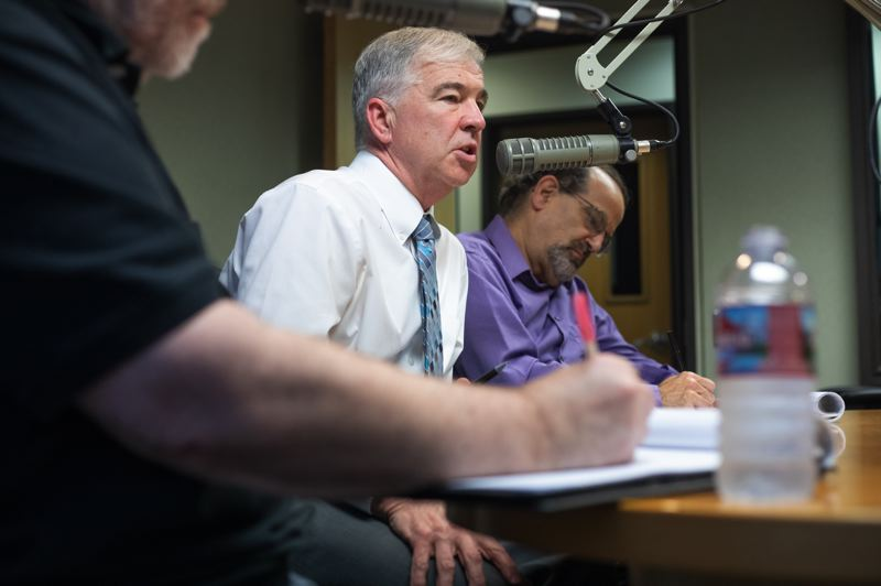 PORTLAND TRIBUNE: JONATHAN HOUSE - Pamplin Media Group Publisher and President asks the candidates for City Council a question while Portland Tribune editor Steve Law (background) takes notes.