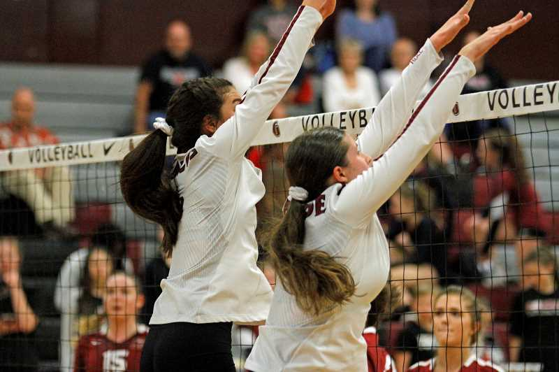 STAFF PHOTO: WADE EVANSON - Glencoe's Jayda Lee and Maggie Gerber attempt to block a Sherwood spike during the Tide's game against Sherwood Thursday, Sept. 27, at Glencoe High School.