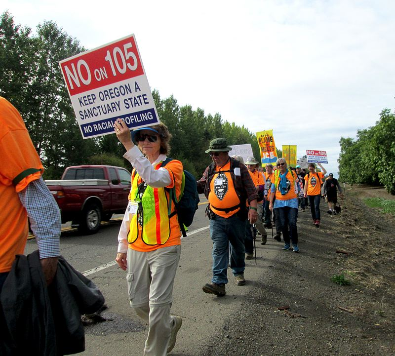 PAMPLIN MEDIA GROUP: KEVIN HARDEN - People marching from Sheridan to The Dalles also planned to canvass and rally in cities along the way to oppose Measure 105, which would repeal Oregon's sanctuary law.