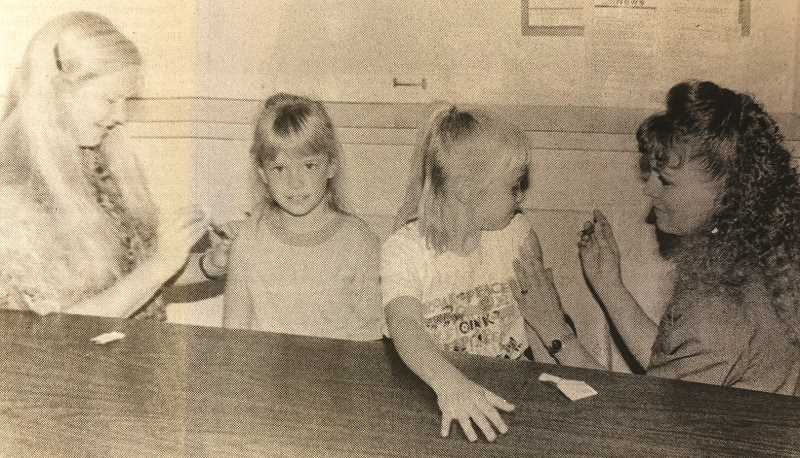 """CENTRAL OREGONIAN FILE PHOTO  - Sept. 30, 1993: Crook County Health Department Director Connie Hoffstetter, R.N., left, demonstrates immunizing her willing """"patient,"""" Jessica Williams, while Debbie George, R.N., right, does the same on Jessica's older sister, Melissa. The two girls were being good examples to other Crook County children, who can take advantage of a free immunization clinic Saturday, Oct. 9."""