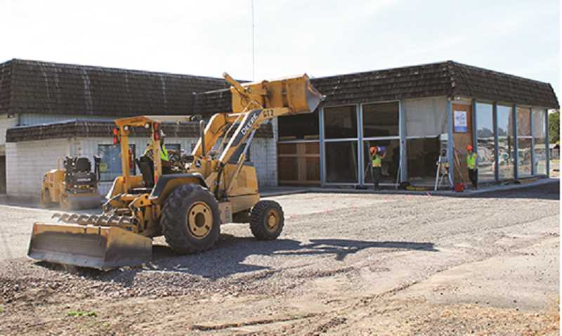 HOLLY SCHOLZ/CENTRAL OREGONIAN  - SMAF Construction works on the parking lot at the old Shrum Ford building.