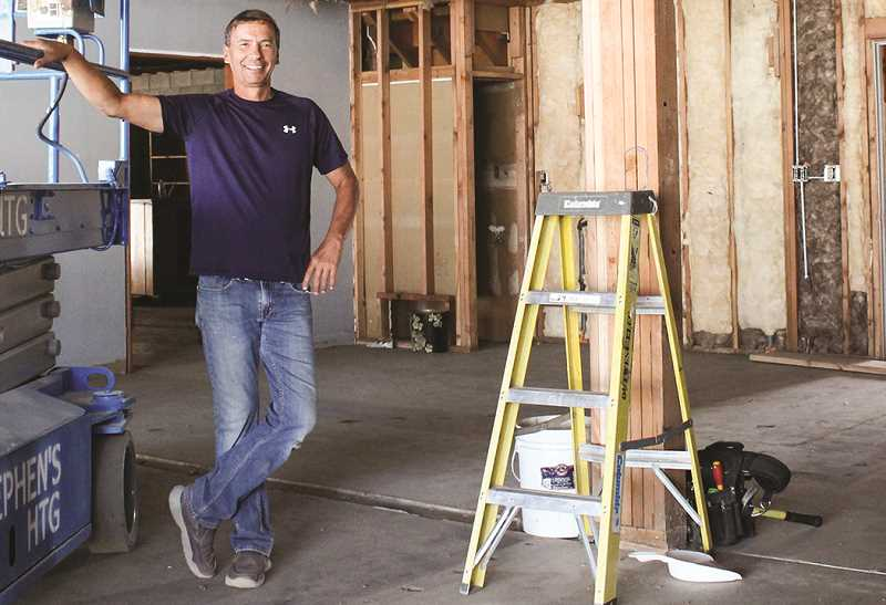 HOLLY SCHOLZ/CENTRAL OREGONIAN  - Sunrise Pools and Spas owner Brad Forseth, above, purchased the former Shrum Ford building on East Third Street this summer and has hired local contractors to renovate the building. He plans to move his business there in December.