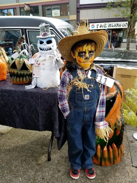 SUBMITTED PHOTO - Tristen Thompson dresses as a creepy scarecrow in downtown Oregon City.