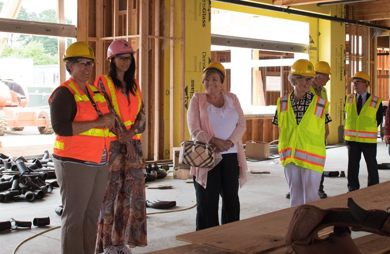 STAFF PHOTO: CHRISTOPHER OERTELL - Cornelius Public Library donors and volunteers take a tour of the under-construction building earlier this year.