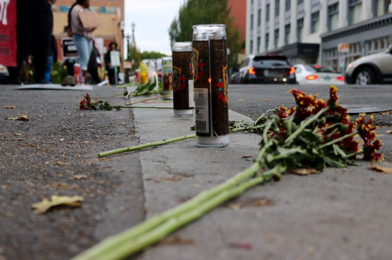 TRIBUNE PHOTO: ZANE SPARLING - Candles and flowers blocked off Southwest Fourth Avenune from Oak to Harvey Milk streets on Monday, Oct. 1 during a vigil for Patrick Kimmons.
