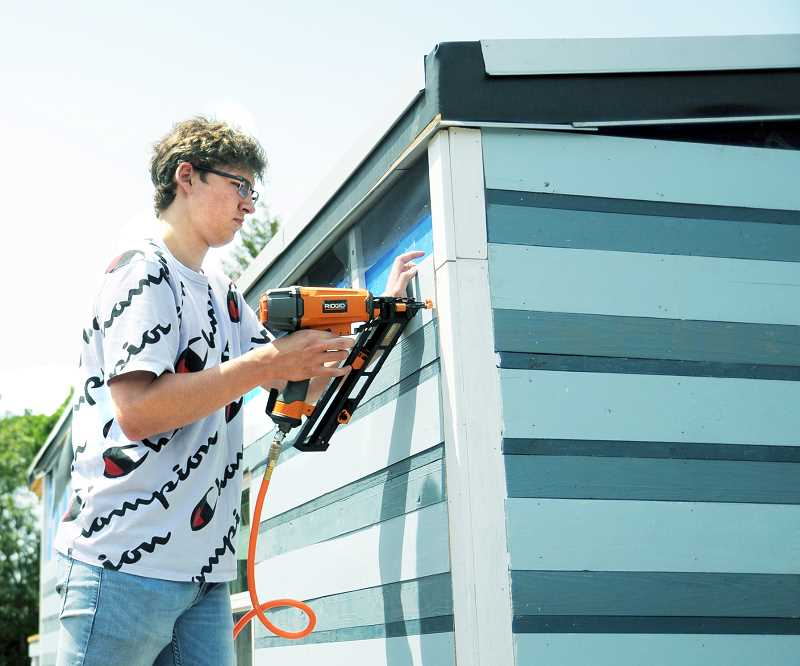 GRAPHIC FILE PHOTO - Volunteers will have the chance to pitch in on construction of a tiny home begun by Newberg High School students during a second work party set for Saturday at the high school.