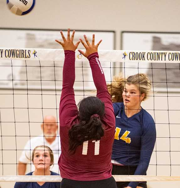 LON AUSTIN/CENTRAL OREGONIAN - Crook County's Kenna Woodward drives a spike past a blocker in a match earlier this year. Woodward and the rest of the Cowgirls finished with a 2-2 record at the Mount Hood Invite.