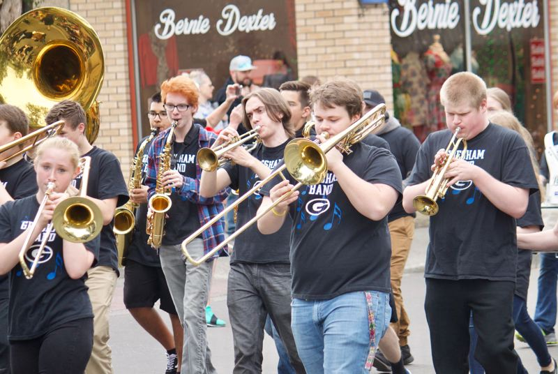 OUTLOOK PHOTO: CHRISTOPHER KEIZUR - Gresham High Schools band got the crowds on their feet as they marched along Main Avenue on Saturday morning, Sept. 29.