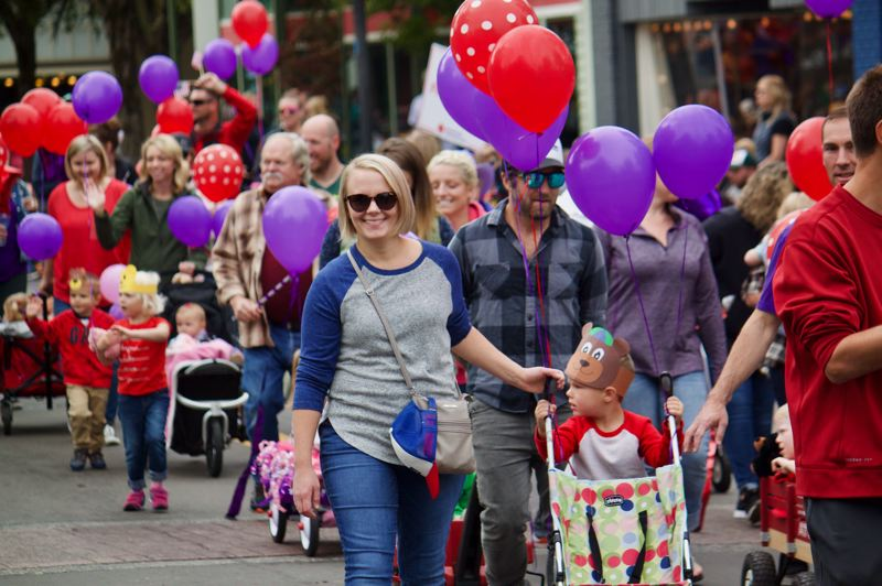 OUTLOOK PHOTO: CHRISTOPHER KEIZUR - City of Gresham's Jessica Harper marched with her family in the Teddy Bear Parade.