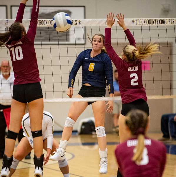 LON AUSTIN/CENTRAL OREGONIAN - Raegan Wilkins hits one of her game-high 11 kills against Redmond on Thursday. The Cowgirls won the match in straight sets as they improved to 4-1 in Intermountain Conference play and 11-3 overall.