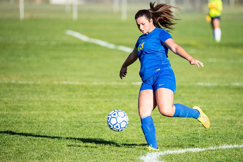 Crook County defender Shelby Squier plays a ball down the field during a match earlier this year. Squire and the rest of the Cowgirls fell 5-0 to the Pendleton Buckaroos on Thursday.