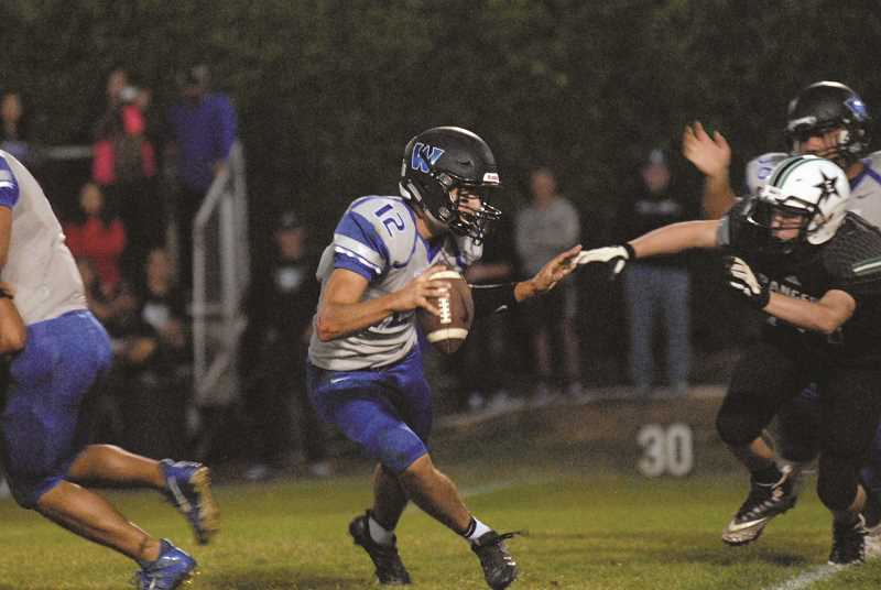 MATT RAWLINGS - Woodburn quarterback R.J. Veliz was responsible for both of the Bulldogs' fourth-quarter touchdowns to keep the team alive, but was stopped at the goal line on a two-point conversation that would have tied the game with 30 left.