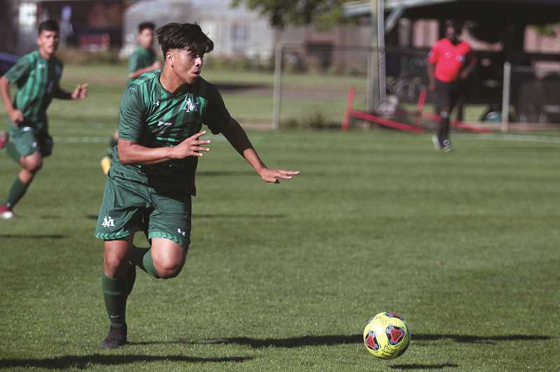 PHIL HAWKINS - North Marion senior Edgar Lopez scored three times in the first three minutes of the second half against Estacada, finishing the game with four goals and two assists in the team's first league win of the season.