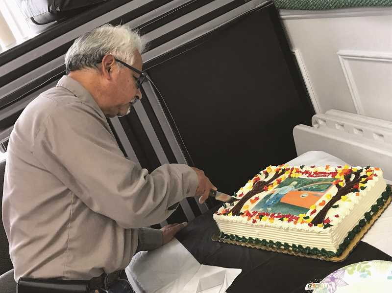 COURTESY PHOTO -  Hubbard Superintendent of Public Works Jaime Estrada cuts the cake at his retirement party, which was held on his birthday at Hubbard City Hall on Sept. 26 last week.