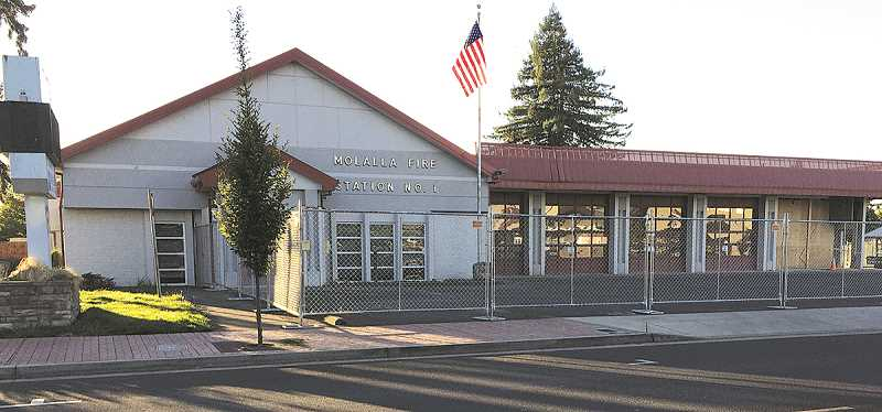 MOLALLA PIONEER: CAROL ROSEN - That fence doesn't mean the Fire Station is closed. It's actually keeping people out while construction crews are upgrading the building for earthquakes.