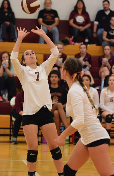 OUTLOOK PHOTO: DAVID BALL - Milwaukie's Chelsea Susemiehl sets a ball in the front row during the Mustang's three-set home loss to St. Helens on Monday night.