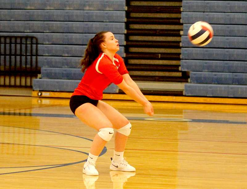 STEELE HAUGEN - Korie Johnson receives a serve during the Buffs' 3-2 home win over the Molalla Indians.