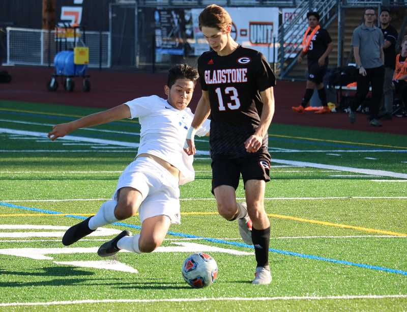 JIM BESEDA FOR THE MADRAS PIONEER - Esteban Gomez makes a slide tackle during the Buffs' 2-1 victory Sept. 25. Gomez scored the first goal of the game.