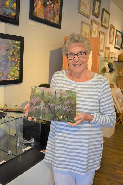 ESTACADA NEWS PHOTO: EMILY LINDSTRAND - Phyllis Flury holds a fused glass piece that is featured in the Spiral Gallery show Four Seasons, which includes work from Flury and  Jerilyn Walker.