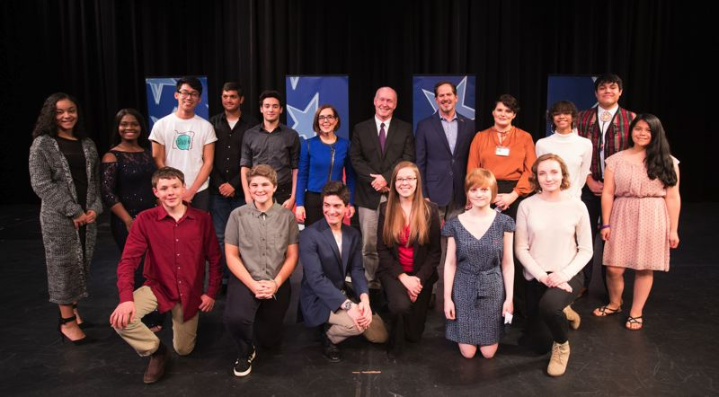 TRIBUNE PHOTO: JAIME VALDEZ - The 15 students who participated in the Debate for Oregon's Future pose for a photo with candidates Kate Brown, Knute Buehler and Patrick Starnes.
